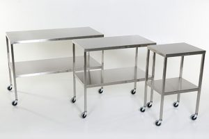 stainless steel instrument tables also known as back tables are used in operating rooms in medical facilities.